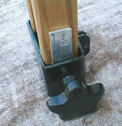 Leg with shield partially out of leg clamp.